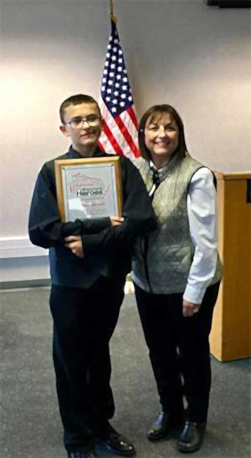 GAB Peer Ambassador Lucas Smith presented Wisconsin Hero Award by Wisconsins First Lady Tonette Walker
