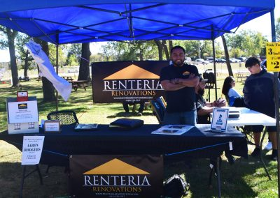 Renteria Renovations table tent set up with Juan standing
