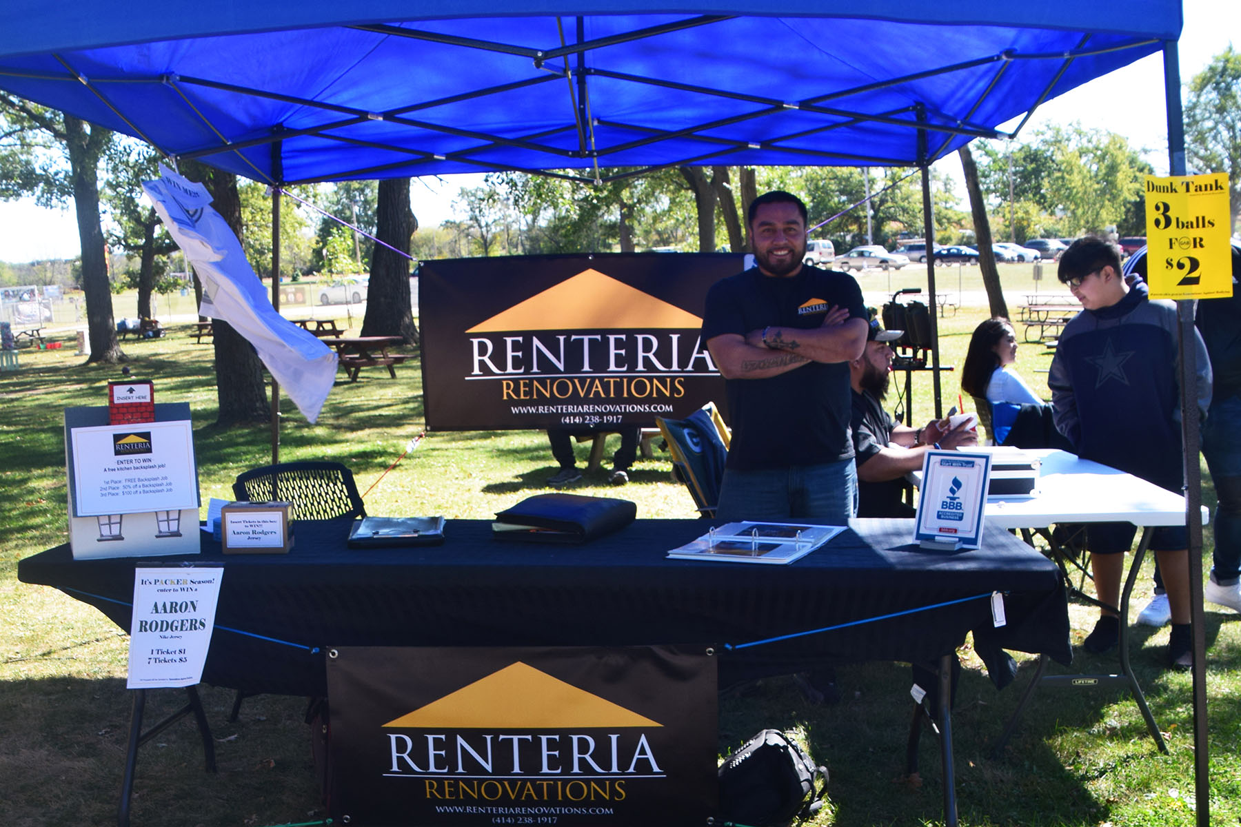 Renteria Renovations table tent set up with Juan standing